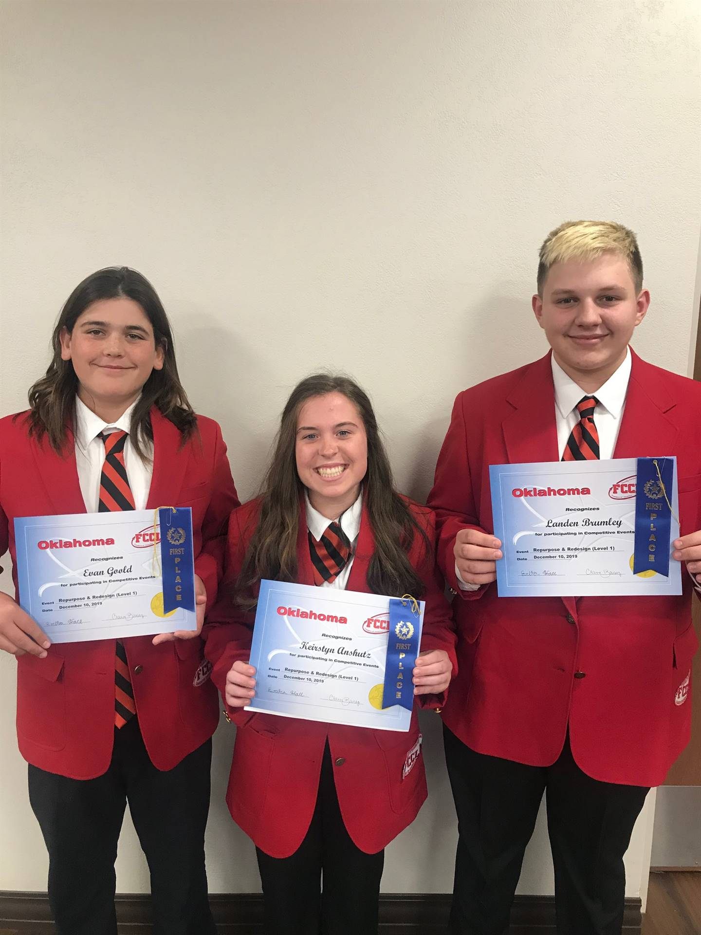 8th grade FCCLA members Keirstyn Anshutz, Landen Brumley, and Evan Goold won 1st place in the Repurp